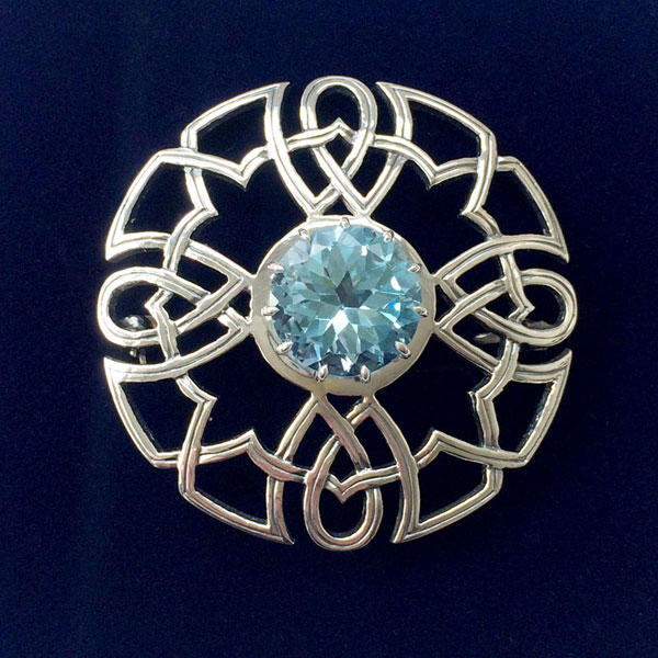 Silver Celtic Brooch set with Blue Topaz